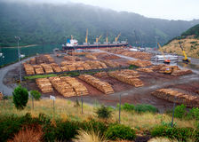 Timber port near Picton NZ. Ship being loaded at the timber port just outside Picton on the South Island of New Zealand Royalty Free Stock Photos