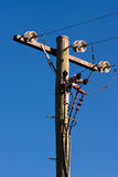Timber power pole and power lines Stock Photo