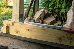Timber and the saw. To build of house Royalty Free Stock Photography