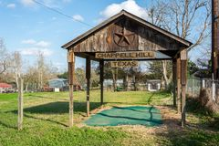 Timber shed with Chappell Hill sign and Texas star. Chappell Hill, Texas, United States of America - December 27, 2016. Timber shed with Chappell Hill sign and stock photos
