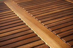 Timber Slats. Thin timber slats form repeating patterns on a table top Royalty Free Stock Photography