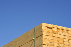 Timber. Stack of freshly cut 2 x 4 size timber planks framed against blue sky royalty free stock image