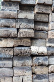 Timber stack. Weathered milled timber stack in wood yard ready for sale Stock Photography