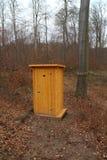 Timber toilet in forest, Kačín Royalty Free Stock Photos