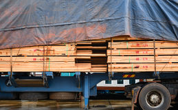 Timber transport truck Park waiting for inspection. With lumber for construction.selective focus Stock Image