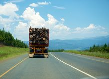 Timber truck driven on the road Stock Photo