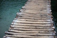Timber walkway across lake Stock Photos