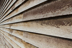 Timber wall. Rustic timber weatherboard wall with pealing brown paint royalty free stock photo