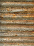 Timber wall of old loghouse. Natural background Royalty Free Stock Image