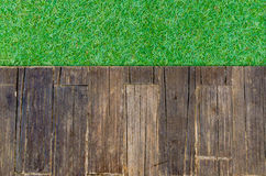 Timber wood brown plank with grass texture background Stock Photography