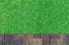 Timber wood brown plank with grass texture background Royalty Free Stock Image