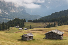 Timbered barns in Dolomites Stock Images