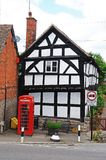 Timbered building and red phone box, Pembridge. Stock Images
