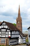 Timbered buildings and church spire, Weobley. Royalty Free Stock Photography
