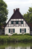 Timbered House. With a lake and in an old-growth forest Stock Photo