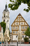 Timbered House from Germany. Timbered House and church tower  from downtown of a south German city Royalty Free Stock Photos