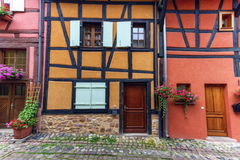 Timbered houses in Eguisheim street, Alsace, France Royalty Free Stock Photos