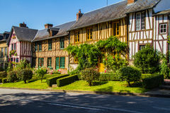 Timbered Houses in Normandy. Norman half-timbered houses in a village in Normandy Le Bec-Hellouin Royalty Free Stock Images
