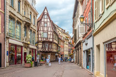 Timbered houses in the streets of Colmar city. Royalty Free Stock Image