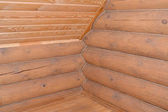 Timbered laying of the wooden house. Fragment of a corner and ce Stock Image