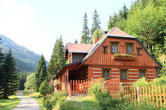 Timbered mountain cottage Stock Images
