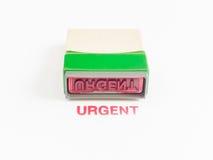 Timbre avec urgent en encre rouge Image libre de droits