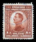 Timbre imprimé portrait dans de la Yougoslavie de royaume Serbie, de la Croatie et de la Slovénie expositions du Roi Alexander I  Photos stock