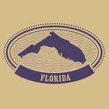 Timbre ovale avec la silhouette d'état de la Floride Images stock