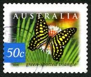 Timbre-poste australien repéré par vert de triangle Photographie stock