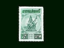 Timbre-poste thaïlandais imprimé dans la representation de la Thaïlande sur le backg noir illustration libre de droits