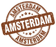 Timbre rond grunge de vintage de brun d'Amsterdam illustration de vecteur