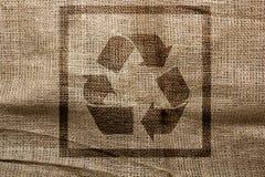 Timbre sur le symbole de réutilisation industriel de toile à sac Photographie stock libre de droits