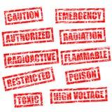 Timbri di gomma nello stile del grunge per avvertimento Immagine Stock Libera da Diritti