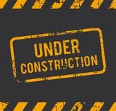 Timbro di gomma in costruzione Immagini Stock