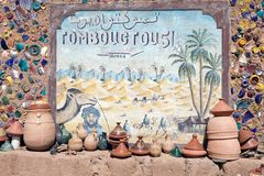 Timbuktu fifty one days travel. The travel indication show the distance, by camel and on foot in the desert, from the village of Tamegroute, in the South of Stock Photography