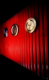 Time #1. Metal clocks along red corrugated wall Royalty Free Stock Photography