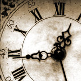 Time. Old looking clock face showing the time Stock Images