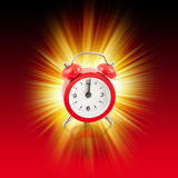 Time is 12 oclock. Explosion 12 oclock with red clock Royalty Free Stock Photo