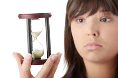 Time. Young business woman with hourglass - time concept Stock Image