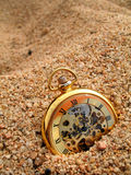 Time. A clock closeup on a beach stock photos