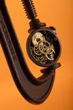 Time. Concept image: Vice squezing an old pocket watch, getting the most out of time Stock Image