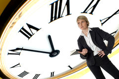 Time. Business woman standing with clock in background concept Royalty Free Stock Images