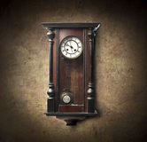 Time. Old wooden pendulum hanging on a wall Stock Photography