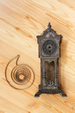 Time. Body and mainspring of old clock on light wood Royalty Free Stock Photos