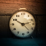 Retro clock. Closeup of retro clock with dark wooden background Stock Images
