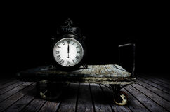 Time. A time piece or clock on an old wooden cart on a worn wooden deck.  Concept for time and its movement Royalty Free Stock Photos