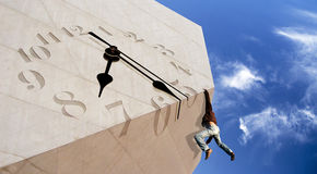 Hard Times. Hard Time concept - Man climbing a concrete block with a melting clock