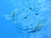 Time. Aqua bay beach clear clock close closeup coast lake macro marine mirror ocean reflection reflections sea seaside shore stopwatch time up watch water wave Stock Photos