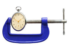 Time. Pocket clock squeezed with clamp Royalty Free Stock Photography