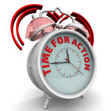 Time for action. The alarm clock with an inscription Stock Photography